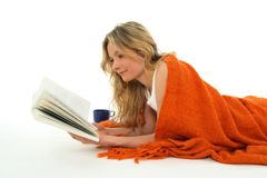 Nice girl reading a book, relaxed stock image