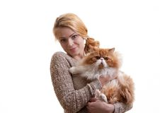 The nice girl with a red cat on hands Royalty Free Stock Photo