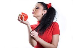 Nice girl in red dress with sweet pepper Royalty Free Stock Photo