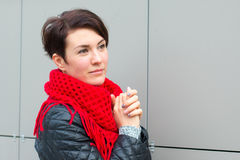 Nice girl in red scarf outdoor. In autumn day Royalty Free Stock Photos