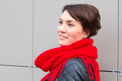 Nice girl in red scarf outdoor. In autumn day Stock Image