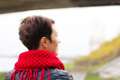 Nice girl in red scarf outdoor. In autumn day Royalty Free Stock Image