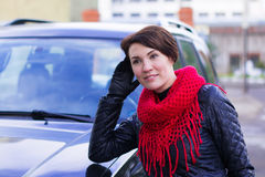 Nice girl in red scarf outdoor. In autumn day Royalty Free Stock Photography