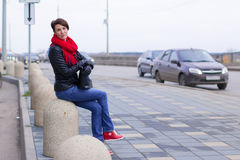 Nice girl in red scarf outdoor. In autumn day Stock Photography