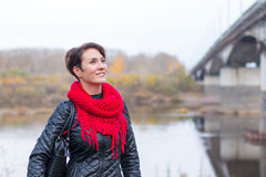 Nice girl in red scarf outdoor. In autumn day Stock Photos