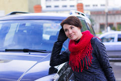 Nice girl in red scarf outdoor in autumn. Day Royalty Free Stock Photo
