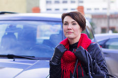 Nice girl in red scarf outdoor. In autumn day Royalty Free Stock Photo