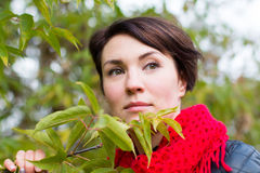 Nice girl in red scarf outdoor. In autumn day Stock Photo