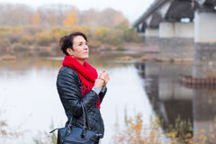 Nice girl in red scarf outdoor. In autumn day Stock Images