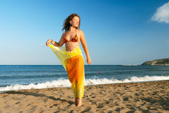 Nice girl relaxing on beach. At morning royalty free stock photography