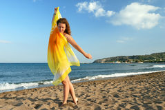 Nice girl relaxing on beach. At morning royalty free stock images