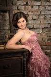 Nice girl in retro interior. Nice girl in evening gown in retro interior royalty free stock photo