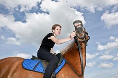 Nice Girl riding a Hors Stock Photos