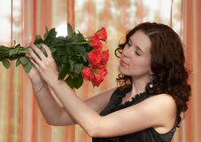 A Nice Girl with Roses Stock Photo
