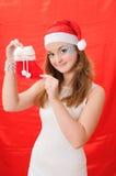 Nice girl in Santa hat hold red sock Stock Photos
