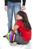 Nice girl sits having embraced boyfriend's leg Royalty Free Stock Image
