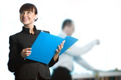 Nice girl with smile and with blue folder Royalty Free Stock Photography