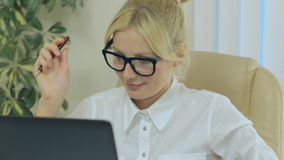 Nice girl smiling and looking at computer screen stock footage