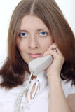 The nice girl speaking by phone. Portrait of the nice girl speaking by phone removed close up Stock Photo