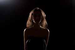 Nice girl in studio. Silhouette. Royalty Free Stock Image