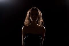 Nice girl in studio. Silhouette. Royalty Free Stock Image