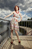 Nice girl in summer light on floodgate Royalty Free Stock Image