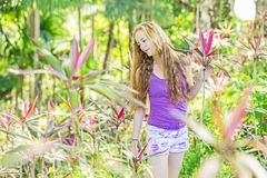 Nice girl in the sunny rainforest Stock Images