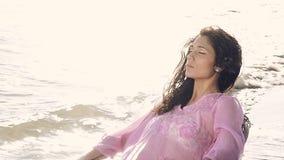 Nice girl taking sun on the beach stock video footage