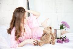 Nice girl with teddy bear Stock Image