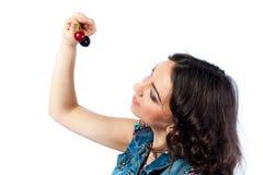 Nice girl and two cherries Stock Photo