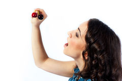 Nice girl and two cherries Royalty Free Stock Image