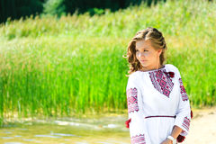 Nice girl in Ukrainian national clothes embroidery on the ri Royalty Free Stock Images