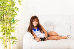 Nice girl with videogame control Stock Photography