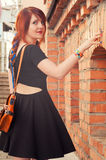 Nice girl waiting you. Young girl waiting you near the antique wall in the old town Royalty Free Stock Photography