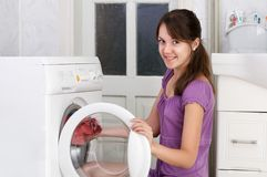 The nice girl is washing clothes. The beautiful girl is washing clothes Stock Photos