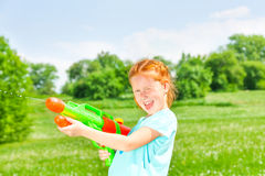 Nice girl with a water gun Royalty Free Stock Photography