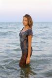 Nice girl in wet clothes Stock Photos