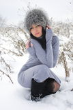 Nice girl in the winter landscape outdoor Stock Photography