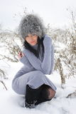 Nice girl in the winter landscape outdoor Stock Image