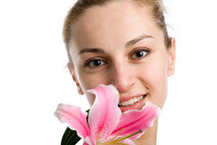 Nice Girl With A Pink Lily Royalty Free Stock Image