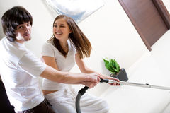 Nice Girl With Vacuum Cleaner And Boy Royalty Free Stock Photo