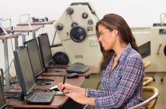 Nice girl working on the desktop computer Stock Photo