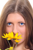 The nice girl with a yellow flower. And dark blue eyes removed close up Royalty Free Stock Photos