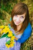 Nice girl and yellow wreath Stock Images