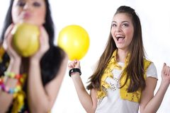 Nice girls with fruit and with balloon Royalty Free Stock Photography