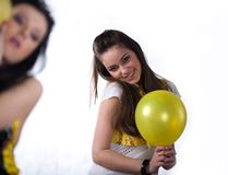 Nice girls with fruit and with yellow balloon Royalty Free Stock Image