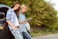 Nice girls holding map Royalty Free Stock Photos