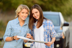 Nice girls holding map Stock Photos