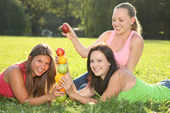Nice girls playing with fruits outdoor Stock Photo