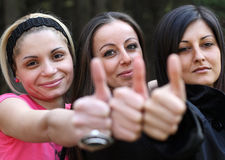 Nice girls wish you good luck and success. Beautiful girls in the park Stock Image